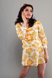 Miniskirt. Pretty slender brunette in a vintage sixties miniskirt Royalty Free Stock Photography
