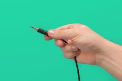Ministeckfassungsverbindungsstück in der Hand Lizenzfreies Stockbild