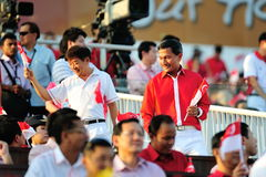 Minister Mr Khaw Boon Wan & Dr Vivian at NDP 2012. Ministers Mr Khaw Boon Wan & Dr Vivian Balakrishnan greeting audiences during National Day Parade 2012 on Royalty Free Stock Photo