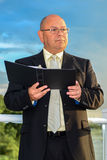 Minister. Reading good book outdoor ceremony blue sky Royalty Free Stock Photography