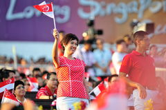 Minister of State Josephine Teo waving flag Royalty Free Stock Photo