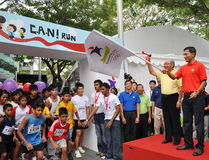 Minister Vivian Balakrishnan flagging off a run. Minister for Community Development, Youth and Sports, Dr Vivian Balakrishnan flagging off a run at the launch of Stock Photo