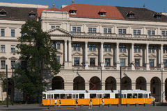 Ministry of Arficulture. BUDAPEST, HUNGARY – AUGUST 5 2017: People waiting for yellow tram in front of Ministry of Agriculture Stock Photos