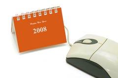Minitischplattenkalender- und Computermaus stockfotos