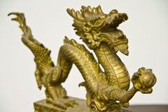 Miniture del dargon dell'oro Fotografie Stock Libere da Diritti