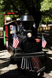 Miniture Rail Road Train With US Flags Stock Photography