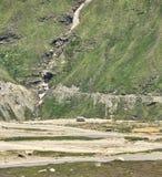 Minivan on mountain serpentine road Stock Image