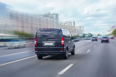 Minivan is moving on the highway Royalty Free Stock Photography