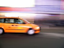 Minivan taxi speeds through Times Square, New York City. A larger minivan taxi speeds through Times Square, New York City stock images