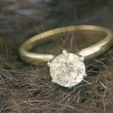 Mink and solitaire diamond sq Stock Photography