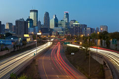 Minneapolis. Image of Minneapolis skyline and highway with traffic lines leading to the city Stock Photos