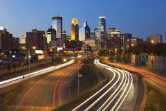 Minneapolis. Image of Minneapolis skyline and highway with traffic lines leading to the city Stock Image