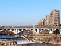 Minneapolis city landscape. A riverside view of the Third Avenue Bridge in Minneapolis, America, with residential tower blocks in the background Stock Photos