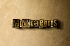 MINNEAPOLIS - close-up of grungy vintage typeset word on metal backdrop Stock Images