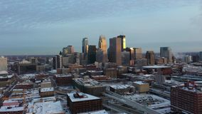 Minneapolis at Dusk - Aerial. Aerial View of Downtown Minneapolis at Night in Winter, City Lights. Minnesota, USA stock footage