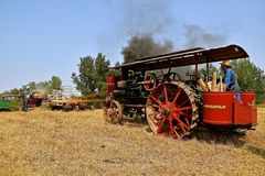 Minneapolis Line threshing machine inaction. ROLLAG, MINNESOTA, Sept 2, 2017: A Great Minneapolis Line steam engine provides the threshing power in a field Royalty Free Stock Photos