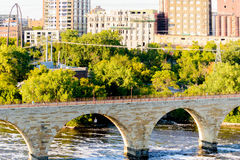 Minneapolis, MN, river and bridge with runner near downtown Stock Photos