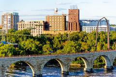 Minneapolis, MN, river and bridge with runner near downtown Stock Photography