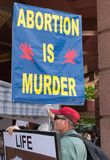 Placard Carrying Anti-Abortion Demonstrator Stock Image