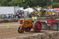 Minneapolis Orange & Red Tractor pulling Stock Photo