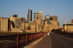 Minneapolis skyline and walkway. Minneapolis skyline viewed from a walkway across the Mississippi River Stock Photo