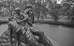 Minnes- Vietnam kvinnor--Skulptur av offret och service Arkivfoton