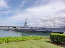 Minnesmärke på den pärlemorfärg hamnen arkivbild