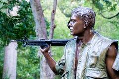 Minnesmärken för tre militärer som firar minnet av vietnamkriget i W Royaltyfri Bild