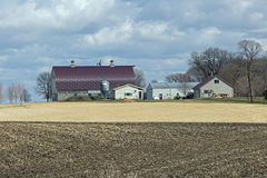 A Minnesota Farm Site. This farm is located in Scott County, Minnesota. It includes a barn, a silo and some various out buildings. A dairy farm was set up to Royalty Free Stock Photo