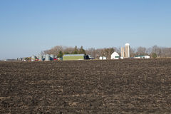 A Minnesota Farm Site. This farm is located in Scott County, Minnesota. It includes a barn, a silo and some various out buildings. A dairy farm was set up to Royalty Free Stock Photography