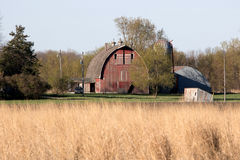 A Minnesota Farm Site. This farm is located in Scott County, Minnesota. It includes a barn, a silo and some various out buildings. A dairy farm was set up to Royalty Free Stock Photos