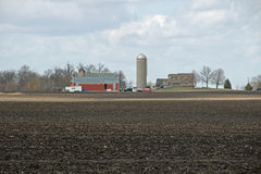 A Minnesota Farm Site. This farm is located in Scott County, Minnesota. It includes a barn, a silo and some various out buildings. A dairy farm was set up to Stock Photography