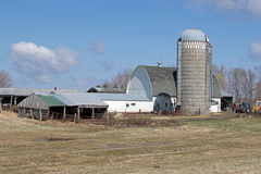 A Minnesota Farm Site. This farm is located in Sibley County, Minnesota. It includes a barn, a silo and some various out buildings. A dairy farm was set up to Stock Photography