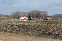 A Minnesota Farm Site. This farm is located in Sibley County, Minnesota. It includes a barn, a silo and some various out buildings. A dairy farm was set up to Royalty Free Stock Photography