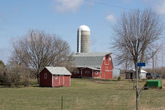 A Minnesota Farm Site. This farm is located in Sibley County, Minnesota. It includes a barn, a silo and some various out buildings. A dairy farm was set up to Royalty Free Stock Image