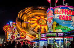 Minnesota State Fair Midway Rides at night. The Minnesota State fair runs for two weeks. The midway is a popular attraction Stock Image