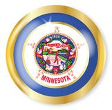 Minnesota Flag Button. Minnesota state flag button with a gold metal circular border over a white background Stock Image