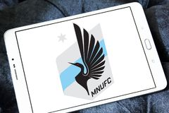 Minnesota United FC Soccer Club logo. Logo of Minnesota United FC Soccer Club on samsung tablet. Minnesota United FC is an American professional soccer club Royalty Free Stock Photography
