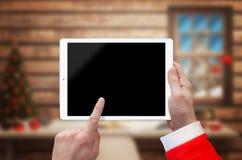 Minnestavla i den Santa Claus handen med den tomma skärmen för modell Arkivfoto