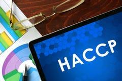 Minnestavla med HACCP på en tabell Royaltyfri Bild