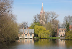 Minnewater in Bruges,  Belguim. Minnewaters in Bruges with the Church of Our Lady at the back Stock Image