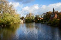 Minnewater damm, Brugge royaltyfri bild