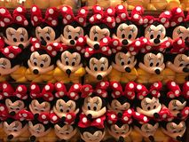 Minnie, Minnie, Everywhere!. Stacks of Minnie Mouse plush toys for sale inside the Magic Kingdom at Disney World Orlando, Florida stock photo