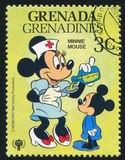Minnie. GRENADA - CIRCA 1979: stamp printed by Grenada, shows Disney Characters, circa 1979 Stock Images
