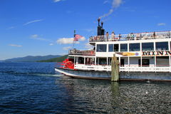 Minnie-Ha-Ha steamboat taking passenger out on Lake George,New York for scenic cruise,July,2013 Stock Photos