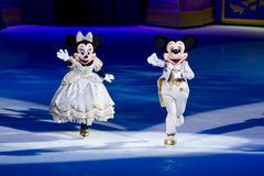 Minnie and Mickey mouse Disney on Ice. Minnie and Mickey mouse skate out during the finale of Disney on Ice Dare to Dream stock photos