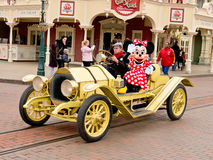 Minnie Mouse in a car. Minnie mouse rides in a classic car at Disneyland paris, March 2012 royalty free stock photos