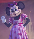Minnie Mouse at the Disney Princess Show. GREEN BAY, WI - FEBRUARY 10: Minnie Mouse in a pink dress waves to the crowd at the Disney Princesses show at the Resch Royalty Free Stock Photo
