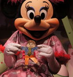 Minnie Mouse with Flat Stanley Stock Photo