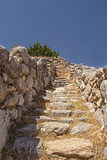 Minoan archeological site, stairs. Old stairs located in Minoan archeological site, Gournia, Crete, Greece, Europe Royalty Free Stock Photo